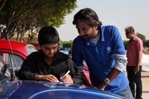Nasir Sabri assisting in filling owner tags.